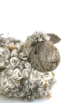 What could be better than a sheep sculpture made from wool! Little woolly lamb just makes me smile and I am quite sure he will have the same