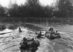 A Soviet machine gun crew crosses a river along the second Baltic front/January 1945