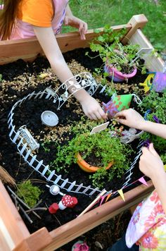 Fairy Garden Table -- plenty of inspiration for imaginative playtime fun! Have you tried having a special garden space for the kids?