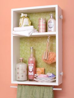 his is one of my favorite ideas: a drawer used as a bathroom shelf and towel hanger.  I like the pretty lining on the back of the drawer.