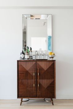 Meaghan was so relieved to find two clients with such clean and sophisticated taste. This bar console from Mitchell Gold + Bob Williams, for example, was one of their investment pieces.