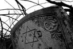 Star of David.  http://www.stoneangels.net/the-afterlife-referenced-in-cemetery-symbolism-part-1/
