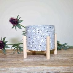 A beautiful Scandinavian style candle pot with terrazzo print set on a grey background. The pot is filled with unscented candle wax and sits on a natural wooden stand, adding contemporary style to your interiors. #candle #candlepot #candleholder #candlestand #scandinavianstyle Home Interior Accessories, Decorative Accessories, Candle Stand, Candle Wax, Scandi Style, Scandinavian Style, Glass Holders, Candle Holders, Grey Candles