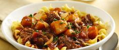 Butternut squash and crushed tomatoes bring color to a beef stew cooked in a robust, red wine broth.