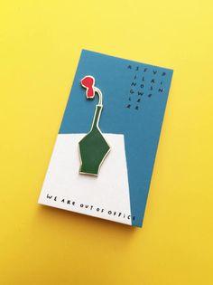 An enamel pin of a single flower vase by weareoutofoffice on Etsy