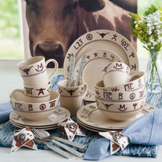 Our Branded Western Dinnerware line is printed with actual cattle ranch brands! Dark brown ranch brands and rope trim printed over a cream background. Shop Your Western Decor. Kitchen Necessities, Dessert Spoons, Western Homes, Old Fashioned Glass, Dish Sets, Canister Sets, Serving Platters, Barndominium, Dinner Plates