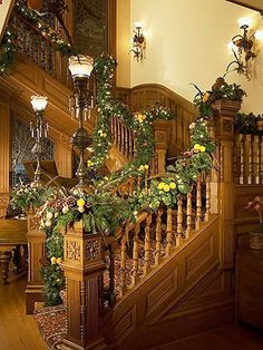 The garland wrapped banister is an idea The Primitive Pinecone staff  LOVES!   Www.hillfarms.com