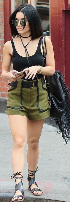 Vanessa Hudgens' green shorts, round sunglasses, Iphone case, and black fringe handbag