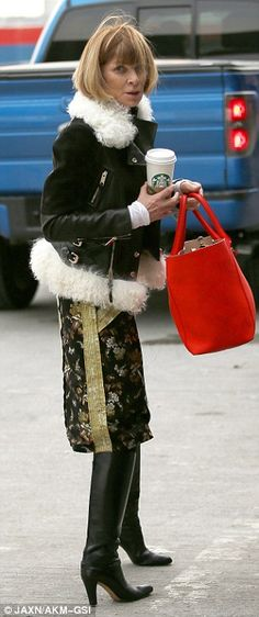 Setting the fashion scene: The 65-year-old was looking chic in a dark floral skirt and fle...