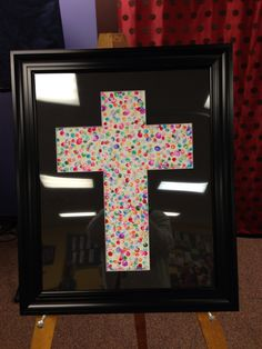 Sorry about the glare !!  Kids finger prints fill in the cross, each kid was assigned a color so you could keep track of who's finger prints they were, you could use any shape!