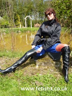 Hayley in a black rubber mackintosh and blue rubber bloomers. Shiny Days, Rubber Raincoats, Wellington Boot, Raincoats For Women, Long Boots, Rain Wear, Black Rubber, Thigh High Boots, Thigh Highs