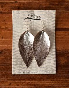 """Metallic leaf-inspired earrings are a simple way to make a striking statement. Empowering marginalized women in Northern India. Color ways available below. Earrings are 3.5"""" long and 1.25"""" wide. All r"""
