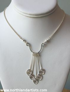 A handmade sterling silver necklace by jewelry artist Susan Pauls, available at Northland Exposure Artists' Gallery, #Parkville, MO. #art   #jewelry   #necklaces   #handmade