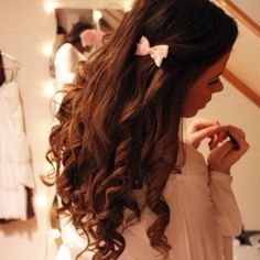 long curly hair with small pink bow