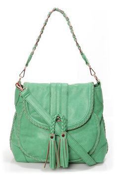 Check it out from Lulus.com! The perfect blend of Bohemian, western, and urban, the Saddle Up Sea Green Handbag by Urban Expressions wears many hats! Matte, sea green vegan leather is finely crafted into a roomy saddlebag with braided trim, exterior zipper pocket, and fringe-y tassels dangling from the front flap. Hidden magnetic closure unsnaps to reveal a front pouch pocket and a zip-top interior with three pockets, plus a cool, floral print lining. Carry from woven tote handle with 9 Cute Purses, Urban Outfits, Green Handbag, Green Bag, Mint Green, Purses And Handbags, Fashion Handbags, Leather Handbags, Vegan Leather