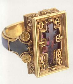 Ecclesiastical Eastern rite Catholic Church ring with a patriarchal cross, cut from one ruby. The lettering on the ring is Medieval European.