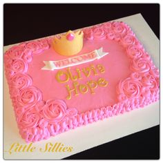 Pink and gold princess themed baby shower cake.