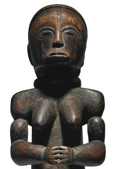 FANG FEMALE RELIQUARY FIGURE, GABON Height: 24 in (61 cm) Sotheby's New york In Pursuit of Beauty: The Myron Kunin Collection of African Art 11 November 2014 Sold 185,000 USD