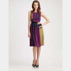 """NWT BCBGMAXAZRIA Arleney Pleated Colorblock Dress BCBGMAXAZRIA Arleney Pleated Colorblock Dress.  Pleated design with a stretchy waistband and variegated stripes.  Scoop neckline.  Sleeveless.  Color: Purple Multi.  Fortuny-pleated top.  Contrasting elasticized waistband.  Accordion-pleated skirt.  Slip-on style.  Fully lined.  About 43"""" from shoulder to hem.  Polyester.  Hand wash.  Small. NWT. BCBGMaxAzria Dresses Midi"""