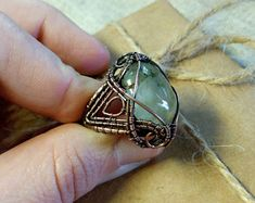 Wire wrapped ring with prehnite Copper prehnite ring Handcrafted prehnite ring Ring with prehnite Gemstone ring OOAK ring Elvish ring Wire Jewelry Rings, Wire Jewelry Designs, Pagan Jewelry, Jewelry Crafts, Jewlery, Wire Wrapped Necklace, Wire Wrapped Rings, Wire Wrapped Pendant, Handmade Rings