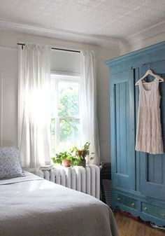 In a tiny space, even a radiator can be the perfect nightstand