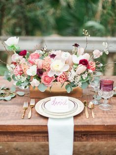 Fresh pink florals + pretty rustic accents: http://www.stylemepretty.com/2015/11/19/wedding-table-settings-that-make-for-a-beautiful-reception/: