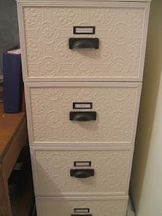 Add textured wall paper to the front of filing cabinets to give them a cute and fun flare.