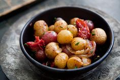 Small new potatoes, roasted with onions, garlic, tomatoes, olives, and herbes de Provence. ~ SimplyRecipes.com