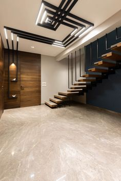 This being a row house interior created with Lavish mix of textures- an approach that is to become the norm of the house. Interior Ceiling Design, House Ceiling Design, Ceiling Design Living Room, Bedroom False Ceiling Design, False Ceiling For Hall, Staircase Design Modern, Home Stairs Design, Home Building Design, Home Room Design