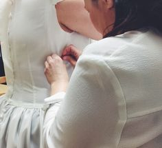 Gillian working her magic, fitting our second bespoke wedding dress! Making its debut in August.