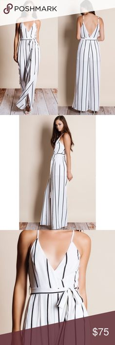 """Striped Maxi Jumpsuit Striped jumpsuit with a tie waist. Available in white and navy. This listing is for the WHITE. This is an ACTUAL PIC of the item - all photography done personally by me. Model is 5'9"""", 32""""-24""""-36"""" wearing the size small. NO TRADES DO NOT BOTHER ASKING. PRICE FIRM. Bare Anthology Pants Jumpsuits & Rompers"""
