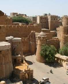 """Jaisalmer Fort, Jaisalmer is one of the largest forts in the world, built in 1156 AD by the Bhati Rajput ruler Rao Jaisal. The fort stands proudly amidst the golden stretches of the great That Desert, on Trikuta Hill, and has been the scene of many battles. It is also known as the """"Golden Fort"""". This fort, popularly known as the 'Sonar quila' by the locals, is located in the very heart the city, and is one of the most breathtaking monuments in the locality."""