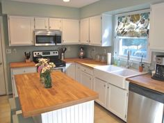 above the sink idea. remove old pointless  cabinet wood....I thought that was your kitchen!!!