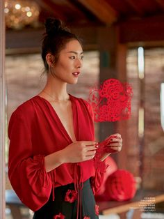 Liu Wen wears red blouse and floral embellished skirt by Michael Kors Collection