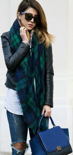 Nicoletta Reggio is wearing a maxi blue and green tartan scarf from Zara