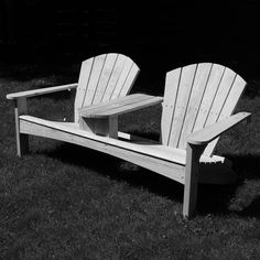 Build a Double Adirondack Chair - Free Project Plan: This classic double settee plan features contoured seats and back splats, inviting you to settle in for a long and comfortable sit. The handy center table is perfect for a fruit bowl and drinks.