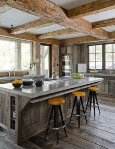 We love the idea of mixing and matching themes that don't necessarily go together at first glance, like this mix of modern accents and rustic, reclaimed wood floors and ceiling beams.
