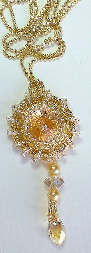 Crystal Rivoli Beadwoven Pendant Unique Jewelry Gold Star.   This unique one of a kind beaded pendant is made gorgeous Swarovski single crystal in delicate creamy colors, circled with gold. This pendant is romantic, elegant and unique.