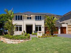 Concrete modern house exterior with porch & landscaped garden - House Facade photo 1437225