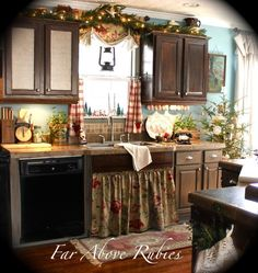 French country kitchen.  Love counter stools with ribbon ties.