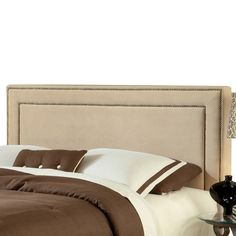 Upholstered headboard with nailhead trim.  Product: HeadboardConstruction Material: Wood and polyester