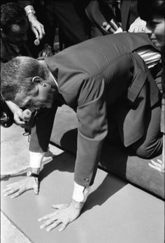 Just 3 days before his 37th Birthday on March 10, 1967 Steve McQueen becomes the 153rd star to put his handprints and footprints on the forecourt of Grauman's Chinese Theater. Wife Neile is at his side. (Courtesy of: Donna Redden)