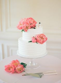 Pretty pink peonies decorate this wedding cake: http://www.stylemepretty.com/rhode-island-weddings/2015/01/16/romantic-rhode-island-mansion-wedding/ | Photography: Robert & Kathleen - http://www.robertandkathleen.com/