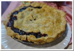 Black Raspberry Pie. . . I needed more berries to fill in my pie, so I threw in some blueberries and also cut up a golden delicious apple and threw it in. Delicious!!!