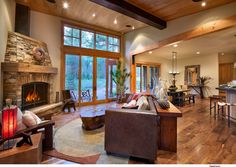 metal, riveted beams, chunky wood framing, wide plank wood floors, trim ganging together windows