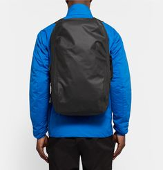 Whether navigating difficult trails or bustling city streets, <a href='http://www.mrporter.com/mens/Designers/Arcteryx_Veilance'>Arc'teryx Veilance</a>'s black 'Nomin' backpack is designed to take you and your essentials from point A to point B. It has been crafted in Canada from durable AC² ripstop nylon and finished with WaterTight™ taped seams to rebuff the effects of wind, moisture and frequent use. Adjust the soft shoulder straps to comfortably distribute the weight.