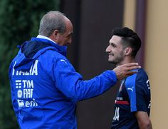 Italian national team head coach Giampiero Ventura (L) and Matteo Politano of Italy chat during the training session at the club's training ground at Coverciano on November 7, 2016 in Florence, Italy.