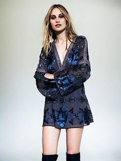 Barcelona A-Line Dress | Seventies inspired printed mini dress featuring cutout trim, in an A-line silhouette. V-neckline with long flared sleeves. | bohemian
