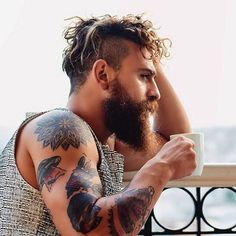 men with curly undercut hairstyle with beard