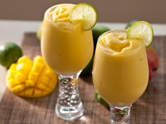 Mango Mock-o-lada: 1 12-oz. bag frozen mango chunks, 1/2 cup cream of coconut, 1/2 cup coconut milk plus more if needed, juice of 2 limes lime and mango slices for garnish (optional).